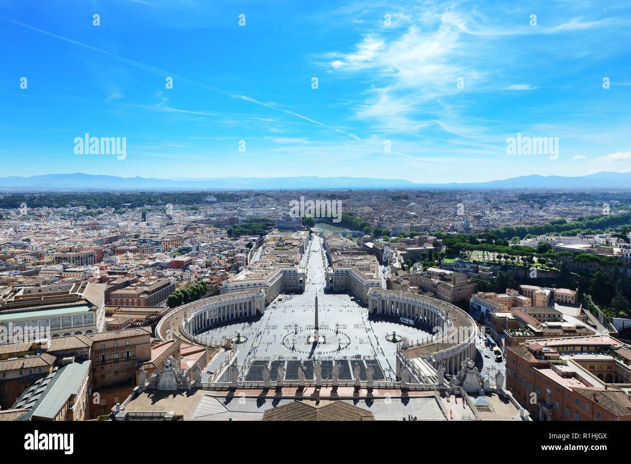 A view of Saint Peter's sq. and Rome as seen from the top of the dome of the Saint Peter's Basilica. - Stock Image