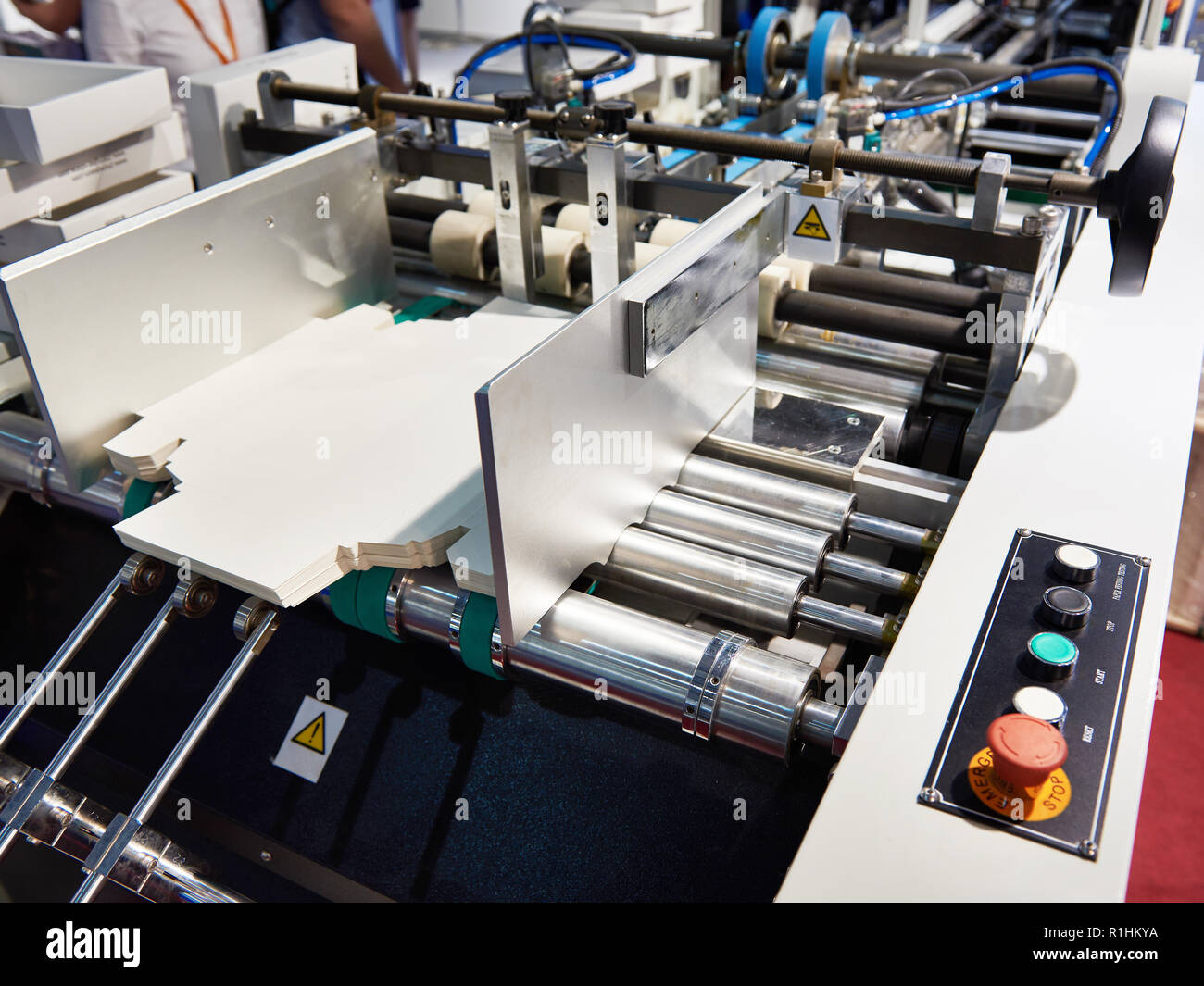Machine for the production of cardboard packaging boxes - Stock Image