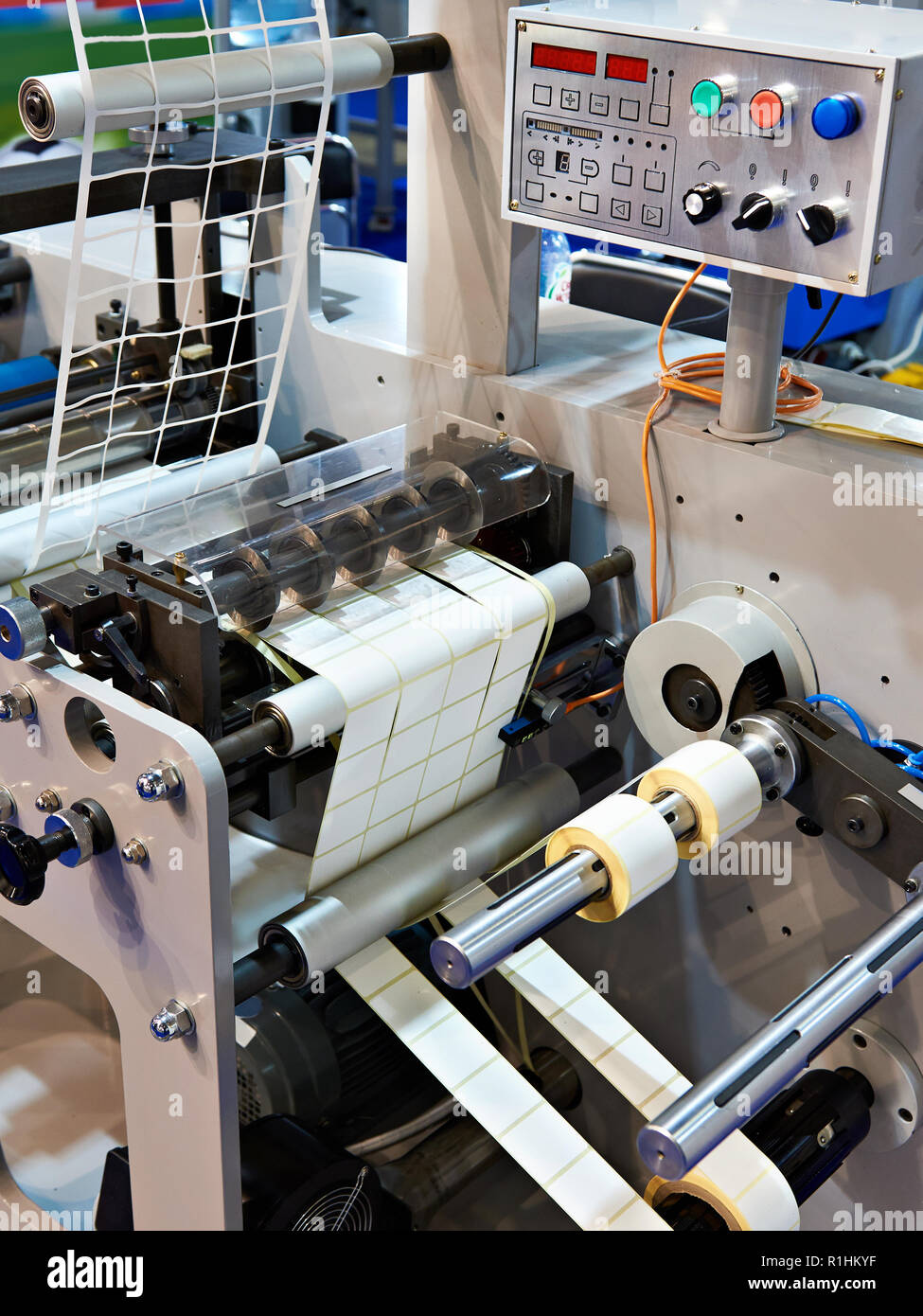 Rotary die cutting machine with slitting blade system - Stock Image
