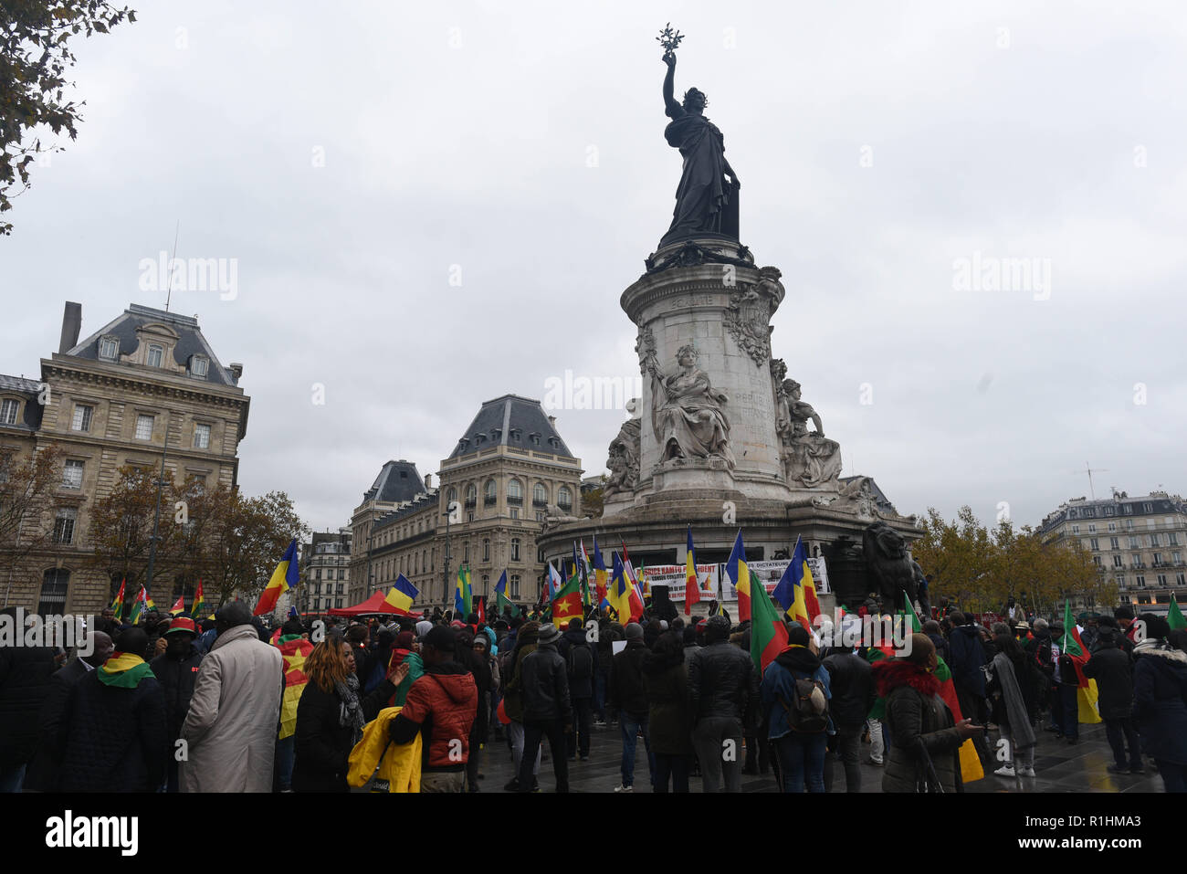 November 10, 2018 - Paris, France: Africans living in France gather in Place de la Republique to protest against the strong relationships between the French government and several African heads of state described as dictators.  Rassemblement place de la Republique a Paris contre les dictateurs africains soutenus par la France. *** FRANCE OUT / NO SALES TO FRENCH MEDIA *** - Stock Image