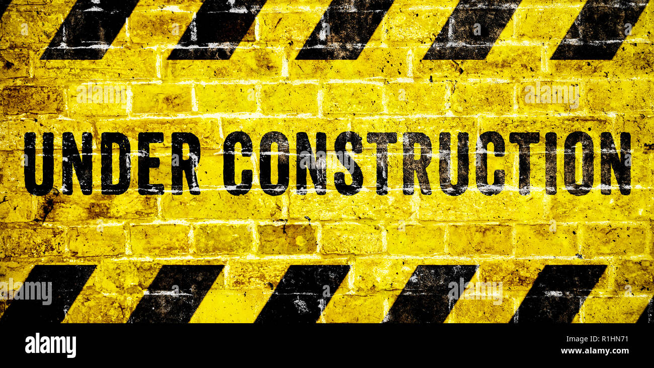 Under construction warning sign with yellow and black