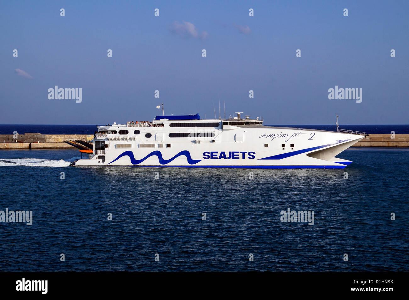 Seajets catamaran Champion 2 leaving the harbour in Heraklion Crete Greece Europe - Stock Image