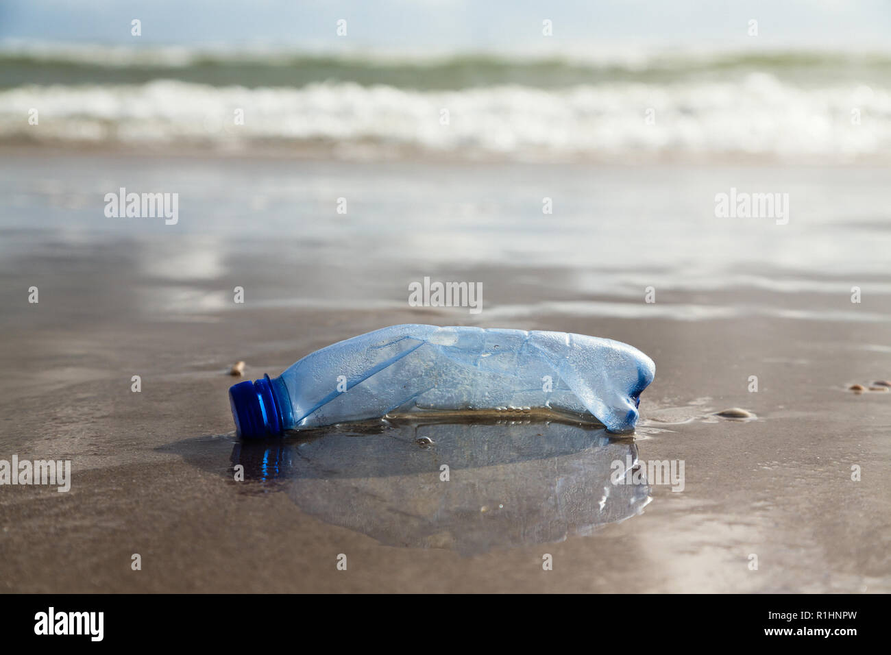 plastic bottle on the beach - Stock Image