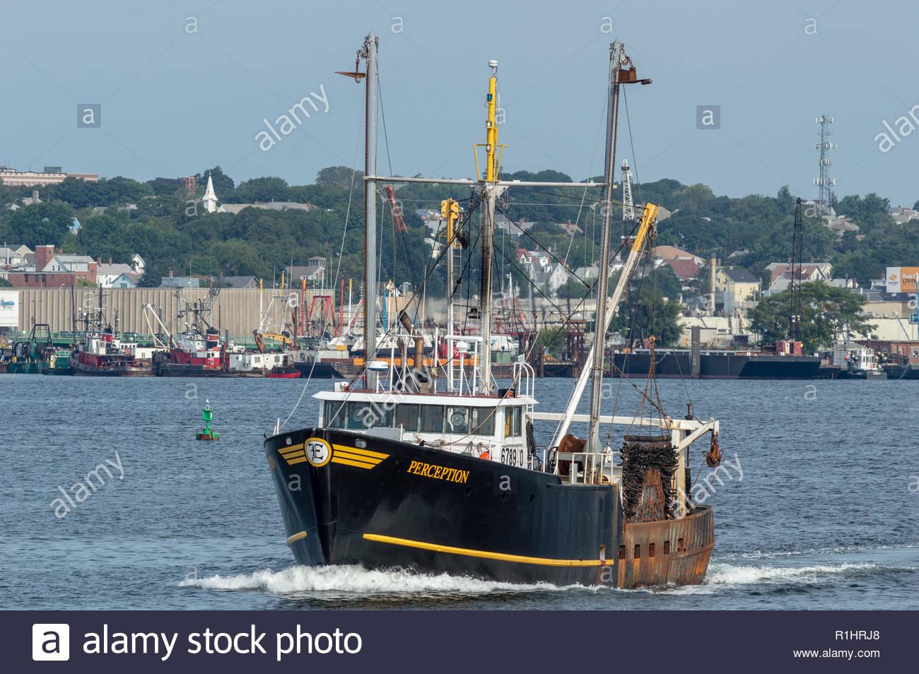 New Bedford, Massachusetts, USA - August 25, 2018: Commercial fishing vessel Perception crossing New Bedford inner harbor - Stock Image