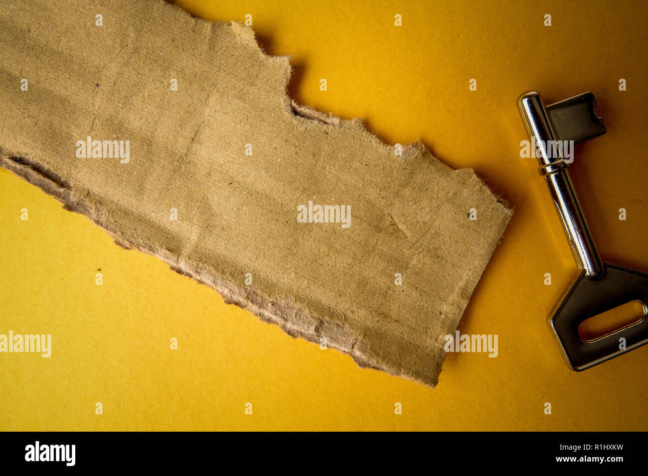 SUCCESS CONCEPTUAL with rustic  brown board and key. - Stock Image