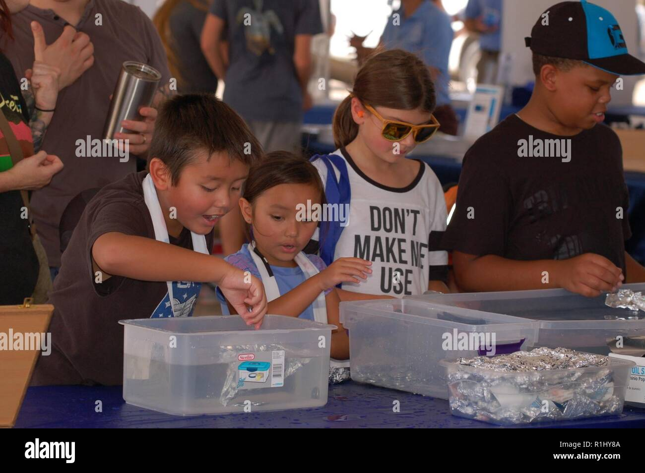 Staff members from the Naval History & Heritage Command were on-hand at the NAS Oceana Air Show offering hands on STEM exhibits. Visitors both young and young at heart had the opportunity to learn about density, sound waves, sonar, and take in some naval history at the exhibit. Stock Photo