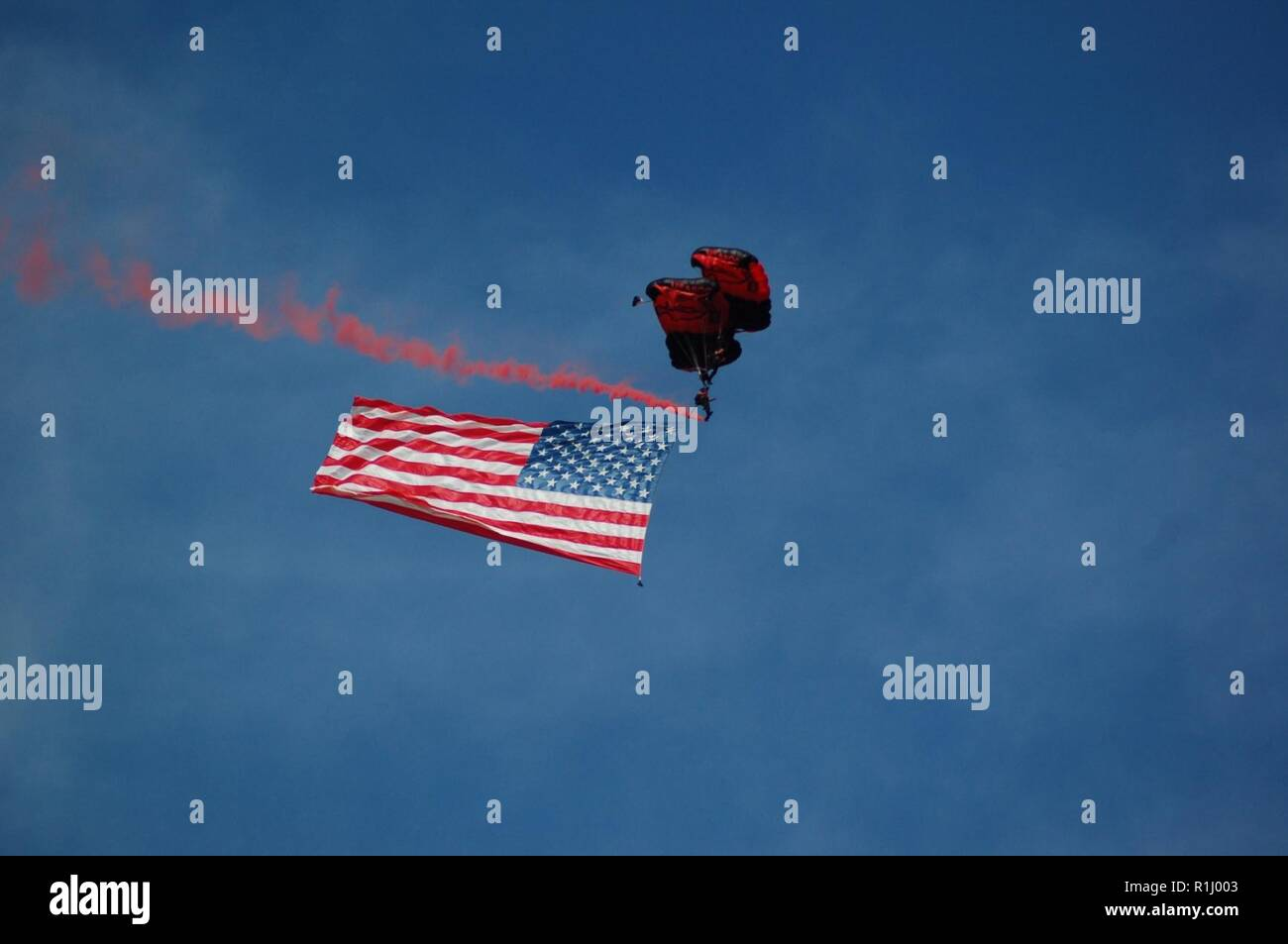 A member of the US Army's Black Daggers Parachute Team flies the American Flag during the 2018 NAS Oceana Air Show. Stock Photo