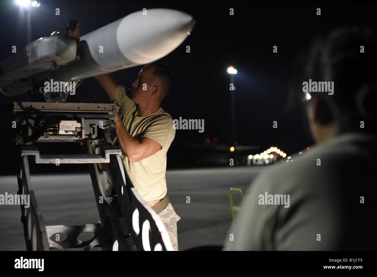 U.S. Air Force Staff Sgt. Sam Kimple, a weapons loader assigned to the 180th Fighter Wing, Ohio Air National Guard, loads live missiles onto an F-16 Fighting Falcon Sept. 20, 2018 during Combat Archer, a two-week air-to-air Weapons System Evaluation Program to prepare and evaluate operational fighter squadrons' readiness for combat operations, at Tyndall Air Force Base, Florida. - Stock Image