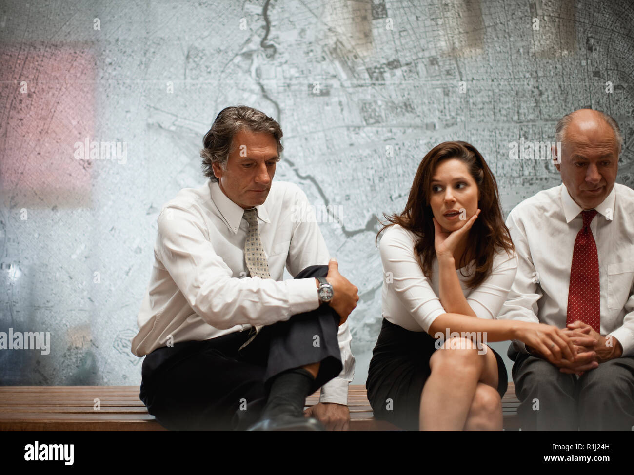 Group of architects at a meeting,  looking worried. - Stock Image