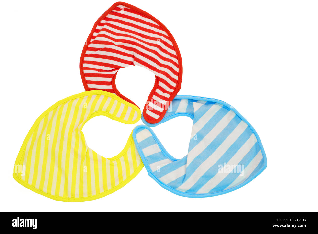 Red, yellow and blue isolated baby bibs - Stock Image
