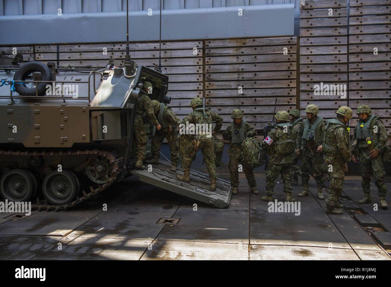 Philippine Sea Oct 06 2018 Soldiers From The Japan Ground Self Defense Force Jgsdf Amphibious Rapid Deployment Brigade Ardb Load Equipment Inside An Aav P7 A1 Assault Amphibious Vehicle As They Prepare To Depart The