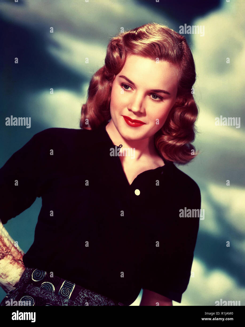 Carroll Baker (born May 28, 1931) is a retired American actress of film, stage, and television. Throughout the 1950s and 1960s, Baker's range of roles from naive ingÈnues to brash and flamboyant women established her as both a serious dramatic actress and a pin-up. After studying under Lee Strasberg at the Actors Studio, Baker began performing on Broadway in 1954, where she was recruited by director Elia Kazan to play the lead in the film of Tennessee Williams's Baby Doll (1956). Her role in the film as a sexually repressed Southern bride earned her BAFTA and Academy Award nominations for Best - Stock Image