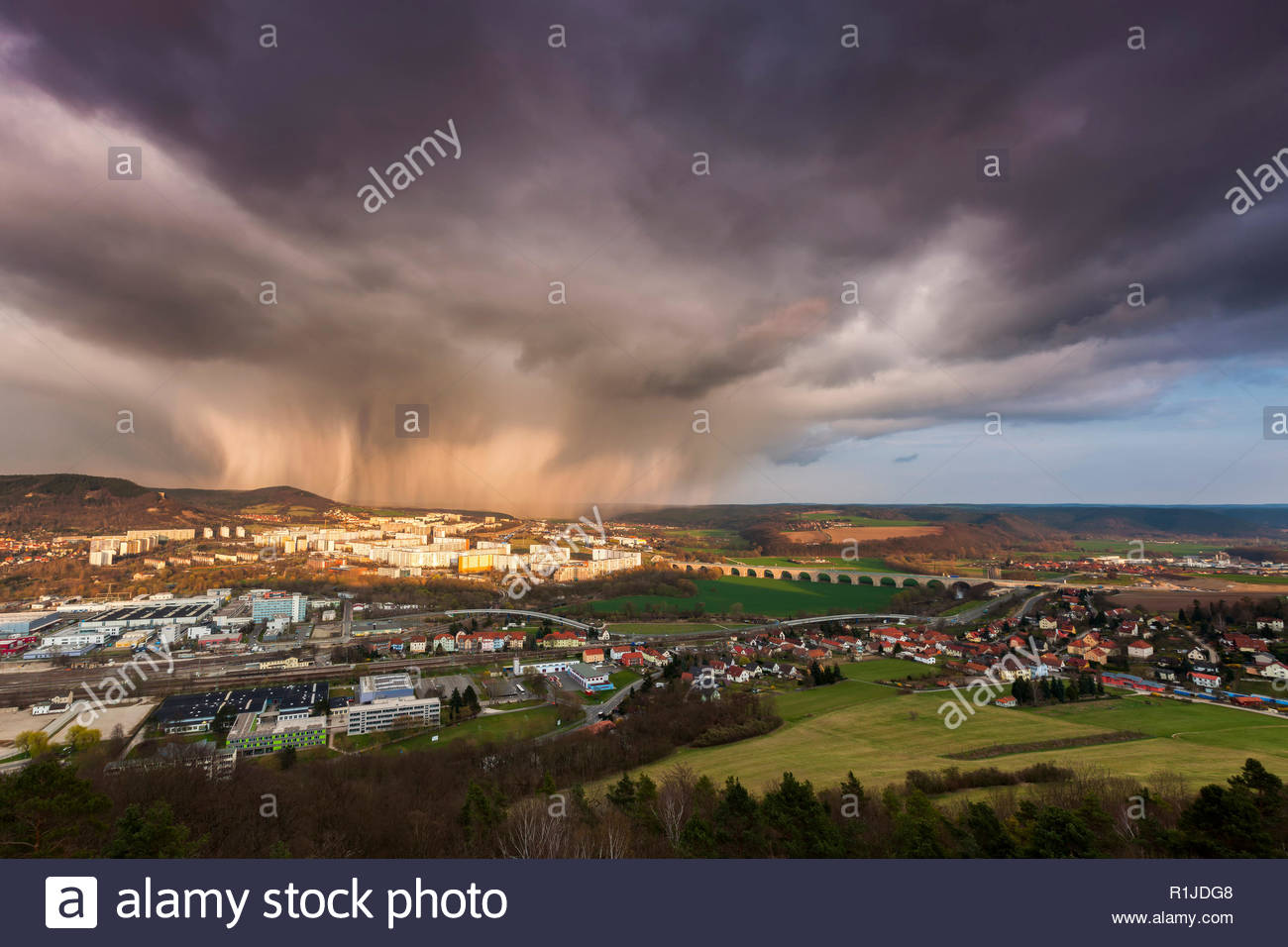 Sleet shower with sunset light on March 25th 2014 in the rear of Neulobeda and Göschwitz, Jena, Thuringia, Germany - Stock Image
