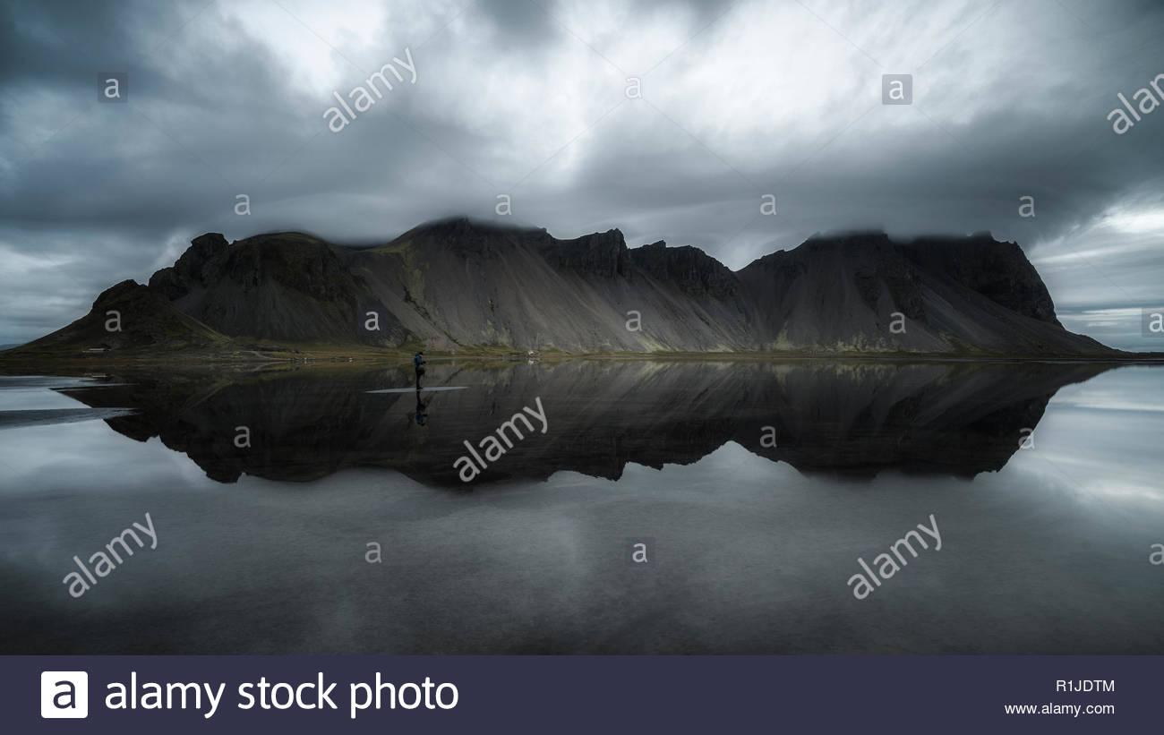 Gloomy mood over Vestrahorn with reflection, Stokksnes, Iceland - Stock Image