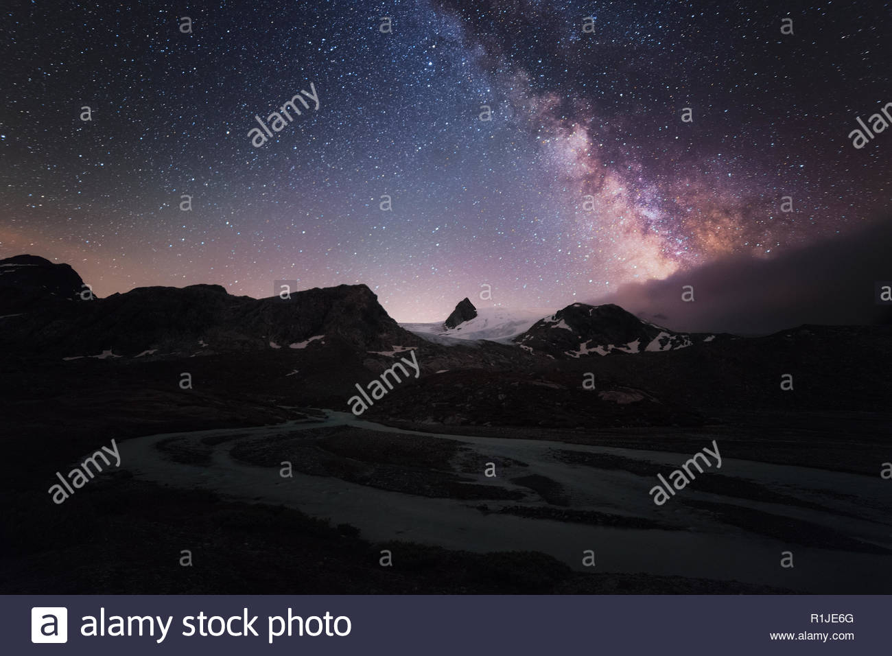Milky Way over glacier runoff, Plateau de Rutor, La Thuile, Aosta Valley, Italy - Stock Image