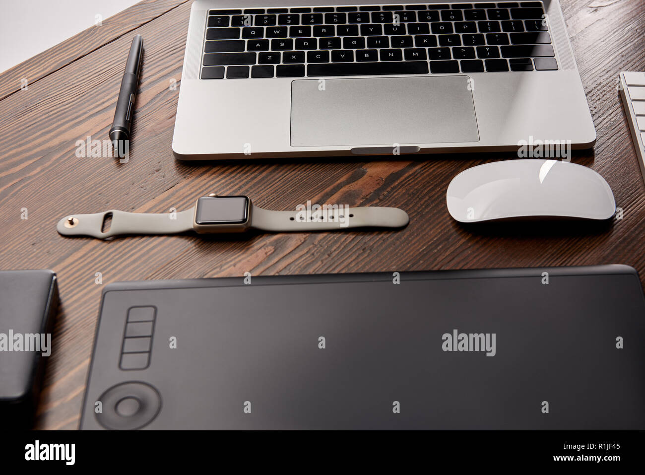 composed various gadgets on graphics designer workplace - Stock Image