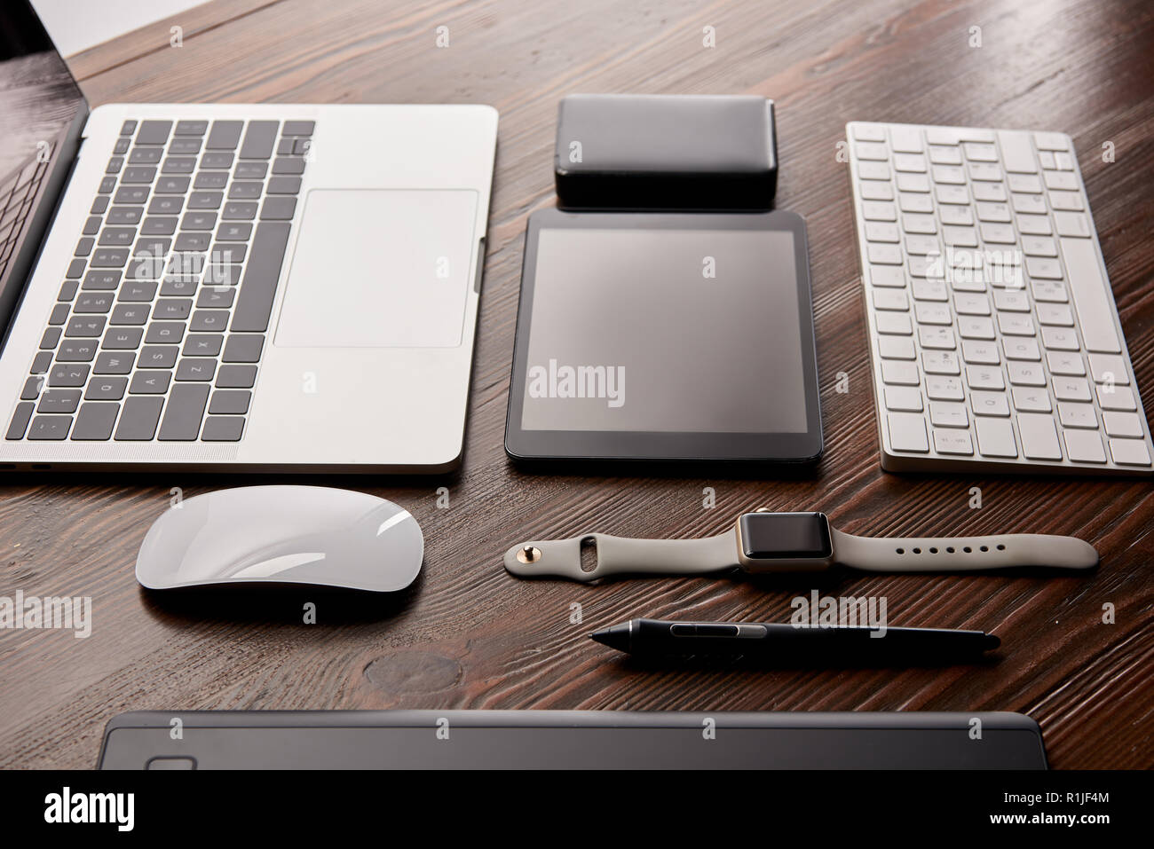 assembled various modern gadgets on wooden table - Stock Image