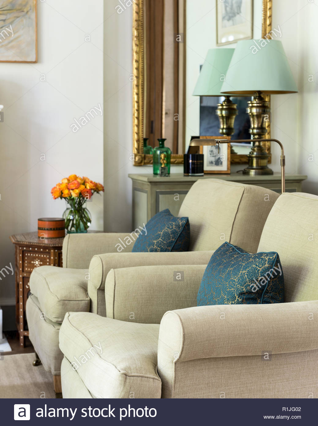 Matching armchairs in country style living room - Stock Image