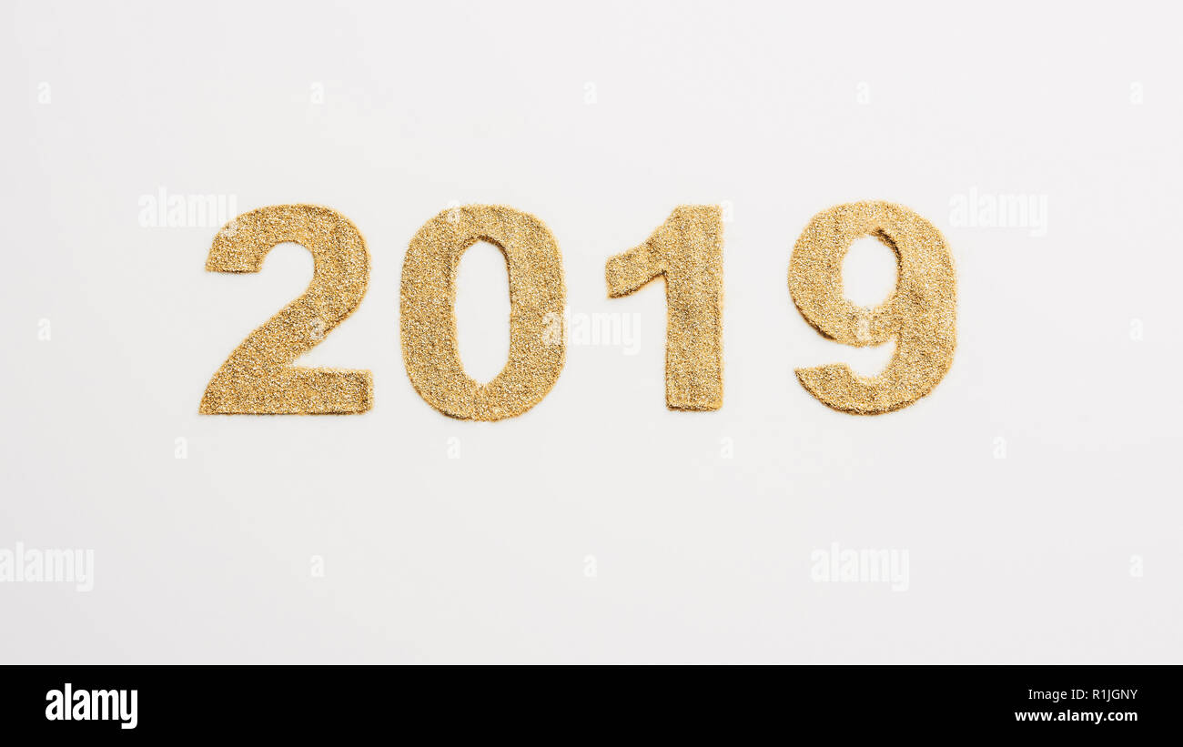 top view of 2019 year sign made of golden glitters isolated on white - Stock Image