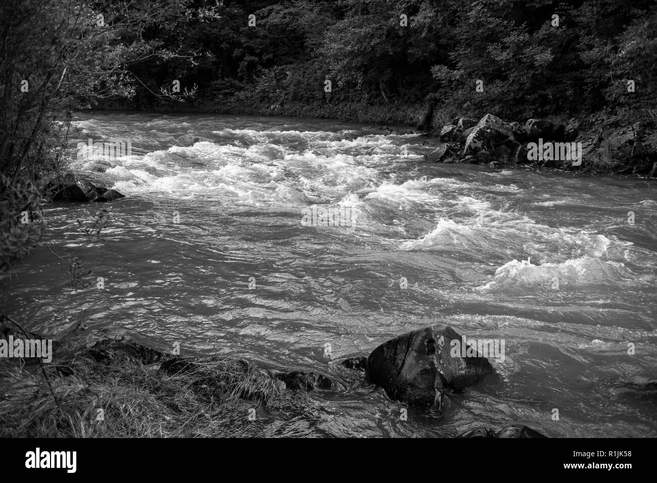 River flows, selective focus, black and white image taken at the Vidima river in Northern Bulgaria Stock Photo