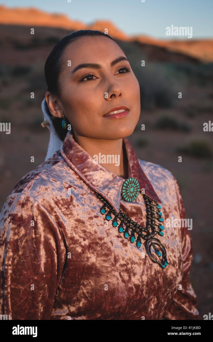 A Navajo Woman Models Her Traditional Dress On A Native American Reservation In Northern Arizona The Woman Wears A Turquoise Skirt And Jewelry Stock Photo Alamy