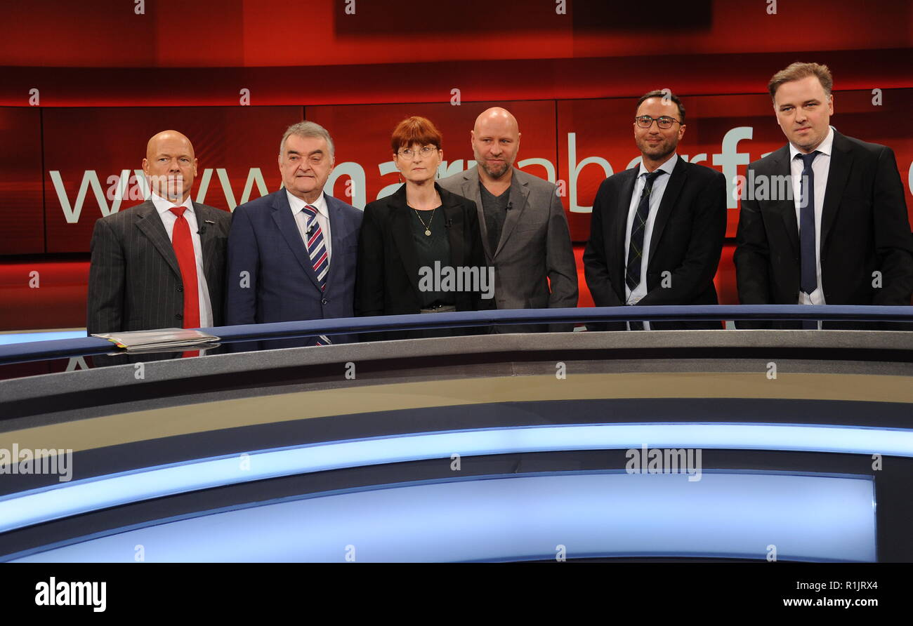 12 November 2018, North Rhine-Westphalia, Köln: The guests of the ARD talk show ' Hart aber Fair ' on 12.11.2018 in Cologne with the topic ' The criminal network of clans - are justice and police powerless? 'Michael Kuhr, l-r, Herbert Raul, Petra Leister, Olaf Sundermeyer, Ahmad Omeirat and Burkhard Benecken. Photo: Horst Galuschka Photo: Horst Galuschka/dpa - Stock Image