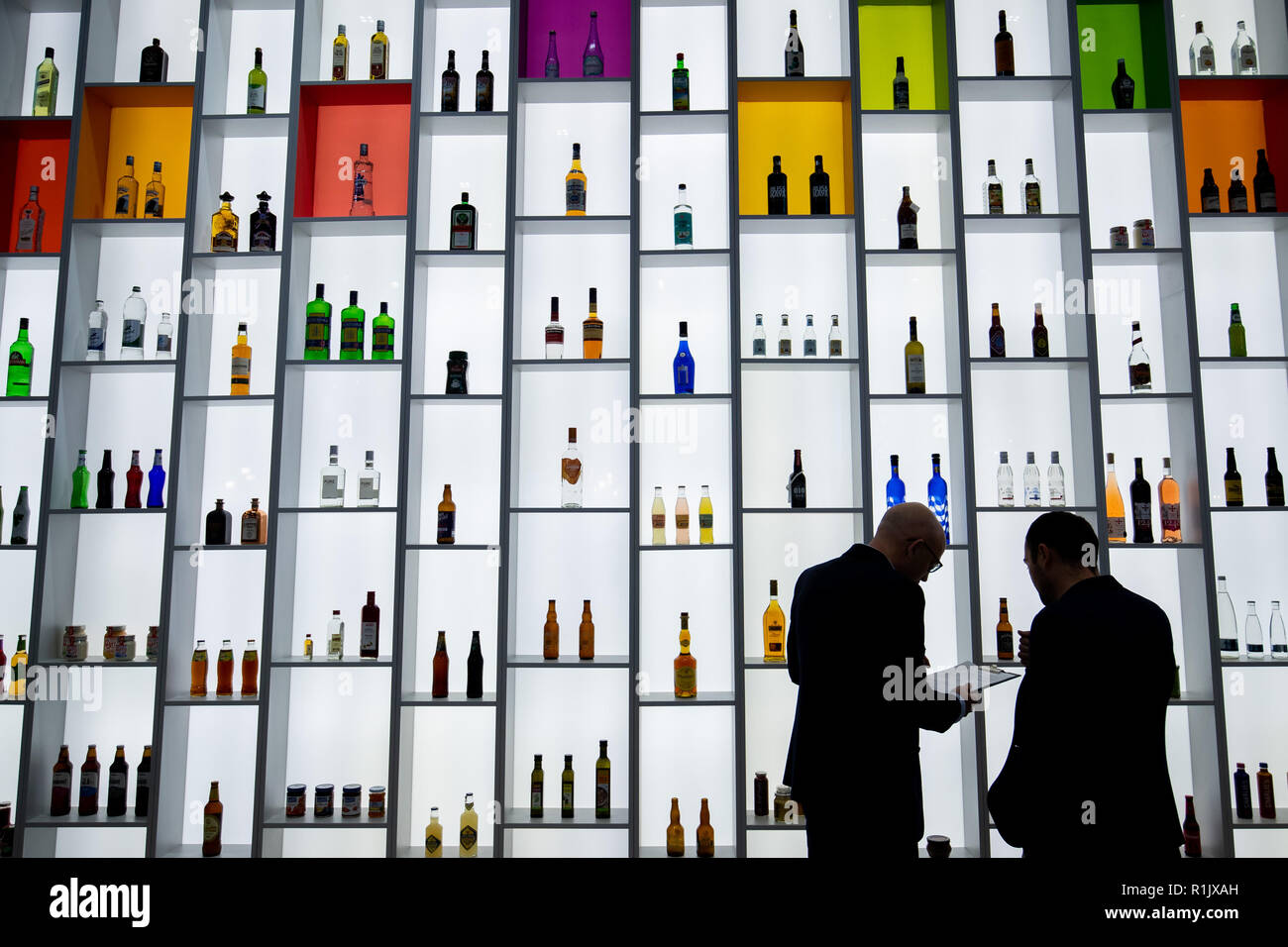 Nuremberg, Germany. 13th November, 2018. Numerous bottles will be on display on a shelf with background lighting at the stand of the US manufacturer of glass containers OI (Owens-Illinois) at the BrauBeviale beverage trade fair. Photo: Daniel Karmann/dpa Credit: dpa picture alliance/Alamy Live News - Stock Image