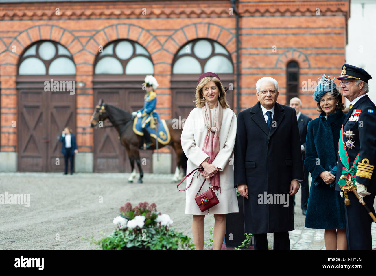 Stockholm, Sweden, November 13, 2018. President of Italy, Sergio Mattarella and First Lady of Italy, Laura Mattarella, visiting Sweden at the invitation of The King of Sweden. The royal couple meets the presidential couple at the Royal Stables for the cortege. Credit: Barbro Bergfeldt/Alamy Live News Stock Photo