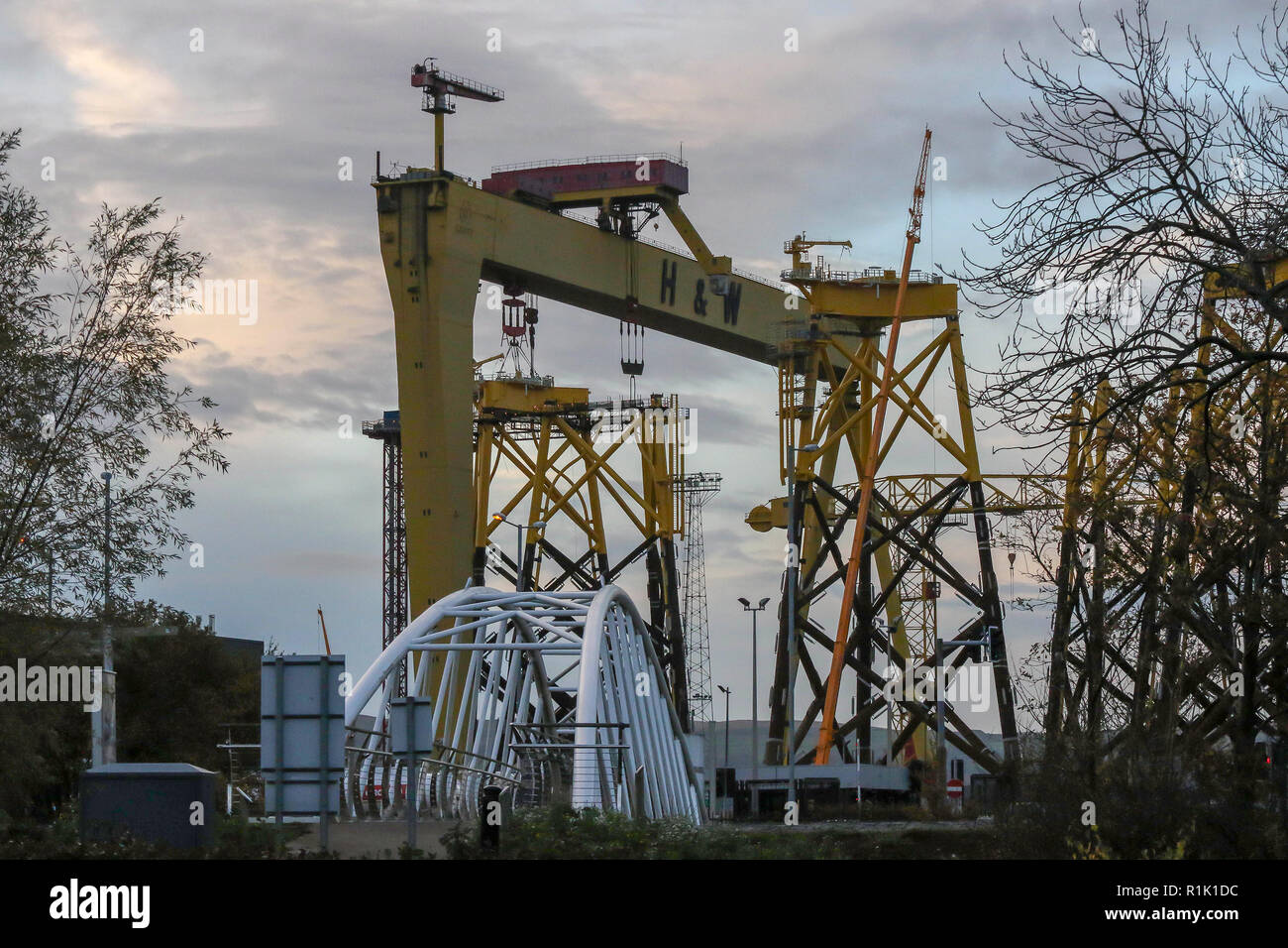 Victoria Park, Belfast, Northern Ireland. 13 November 2018. UK weather - a grey end to the day in Belfast Northern Ireland. Rain is on the way although  the temperature will be mild. Yellow Harland & Wolff crane Belfast Harbour Estate. BHZ Credit: David Hunter/Alamy Live News. - Stock Image