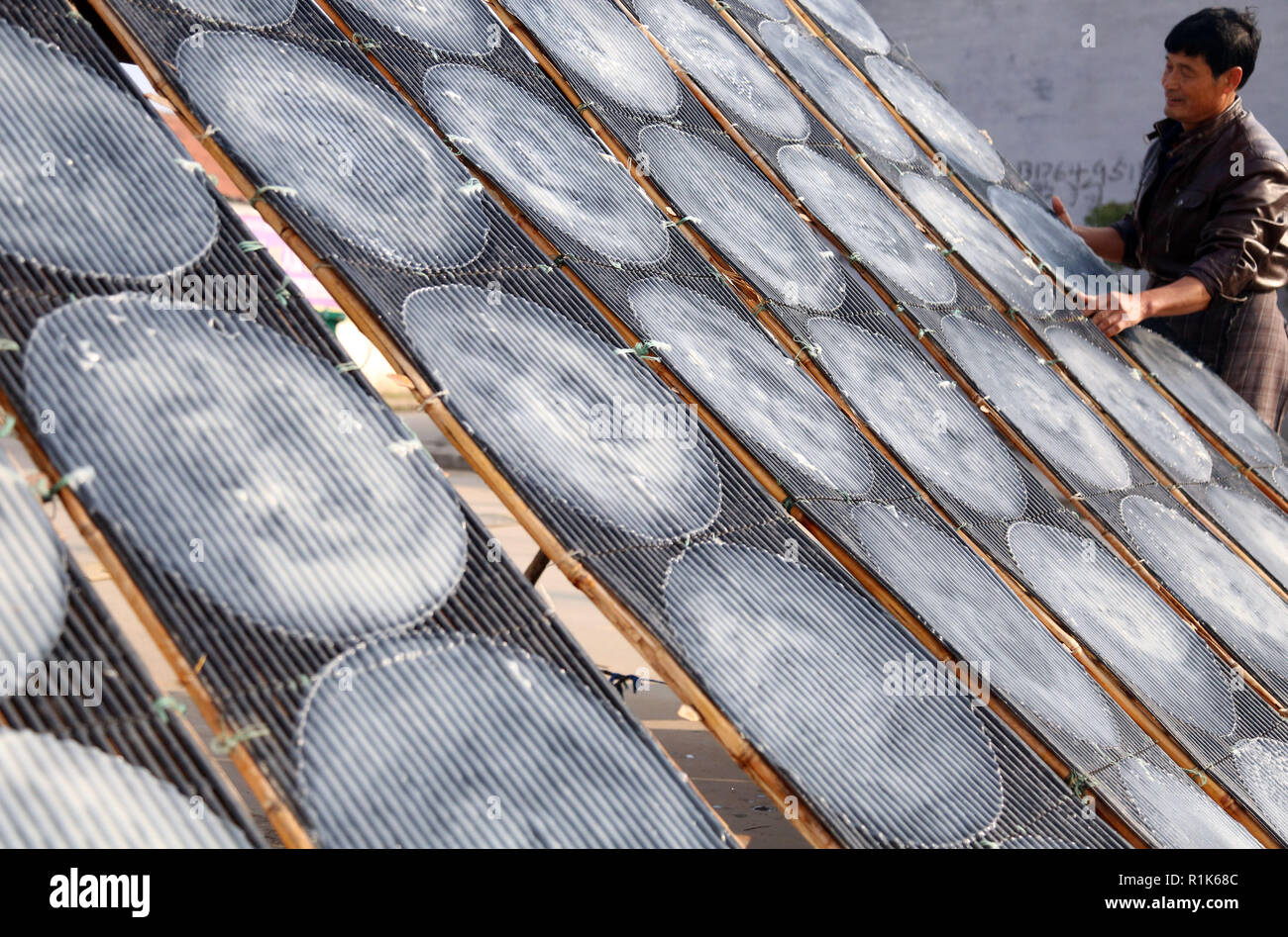 Binzhou, China's Shandong Province. 13th Nov, 2018. A farmer airs sweet potato starch jelly in Dongzheng Village, Boxing County, east China's Shandong Province, Nov. 13, 2018. Credit: Chen Bin/Xinhua/Alamy Live News - Stock Image