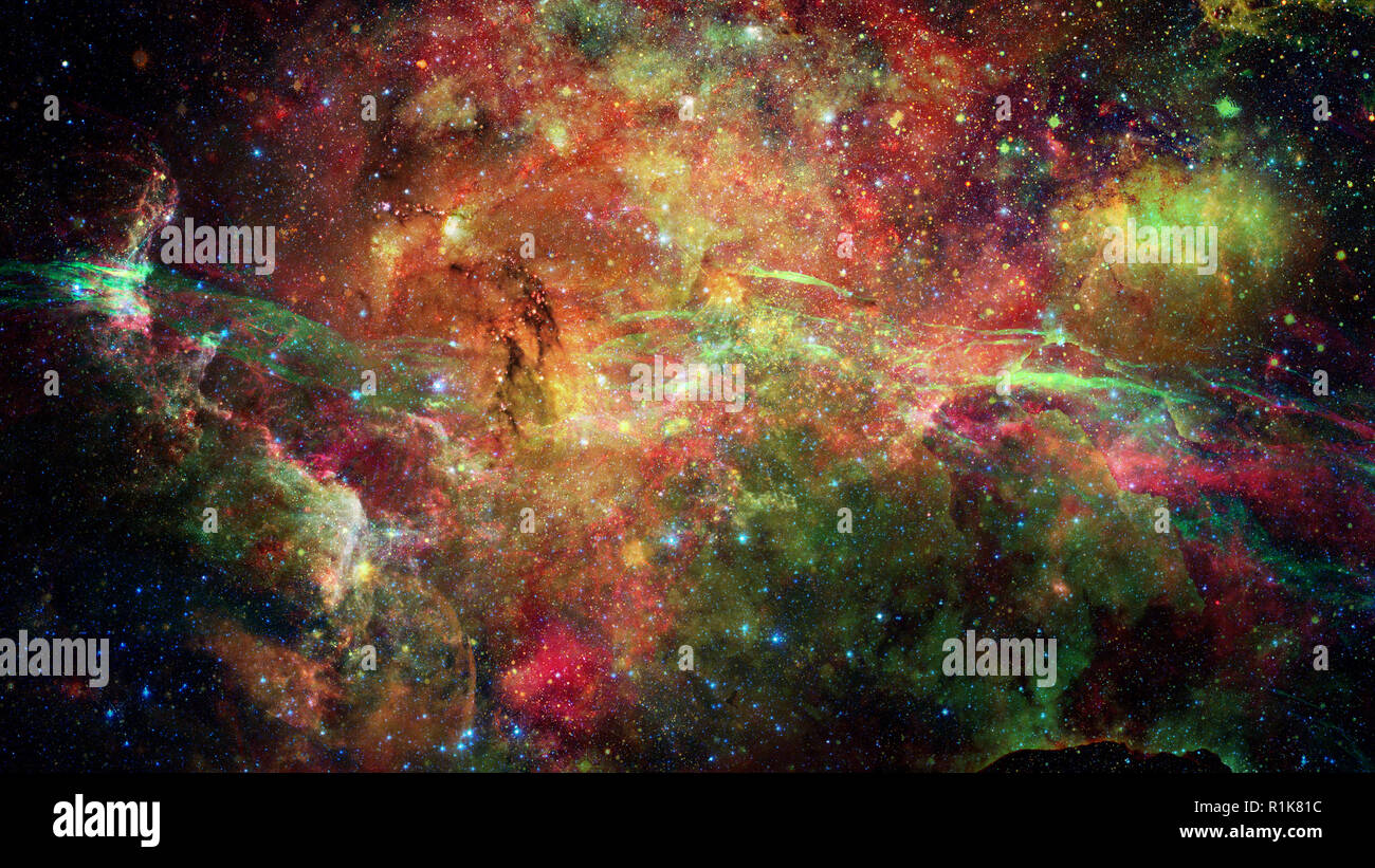 Nebula and stars in deep space. Science fiction wallpaper. Elements of this image furnished by NASA. - Stock Image