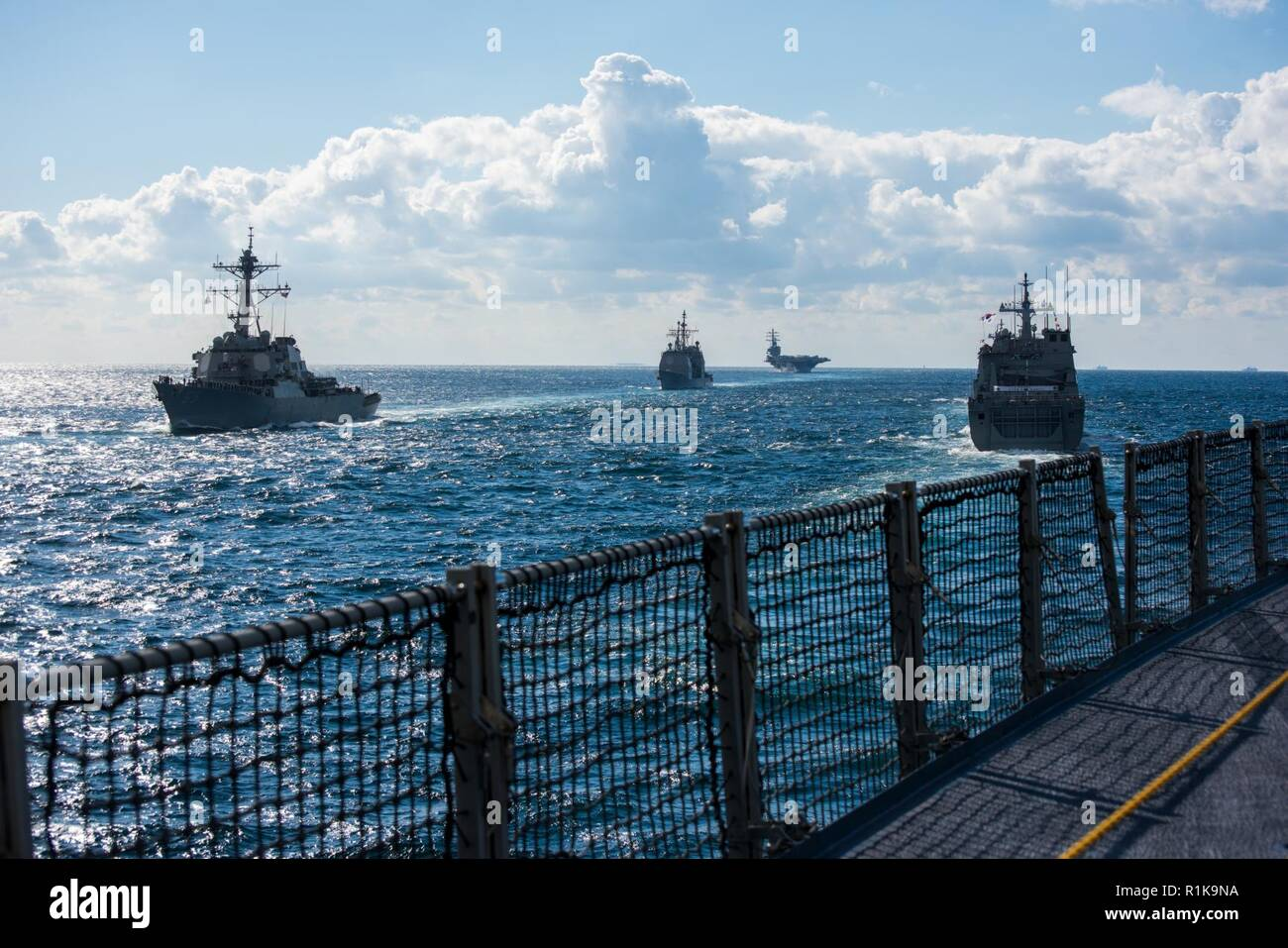 JEJU ISLAND, Republic of Korea, Republic of Korea (Oct. 11, 2018) The guided-missile destroyer USS Benfold (DDG 65), guided-missile cruiser USS Chancellorsville (CG 62) and the forward-deployed nuclear-powered aircraft carrier USS Ronald Reagan (CVN 76) participate in a pass-in-review led by the Republic of Korea Ship (ROKS) Il Chu Bong (LST 688) during the ROK 2018 International Fleet Review (IFR). The IFR is conducted every 10 years and has participants and observers from more than 20 foreign navies. Stock Photo