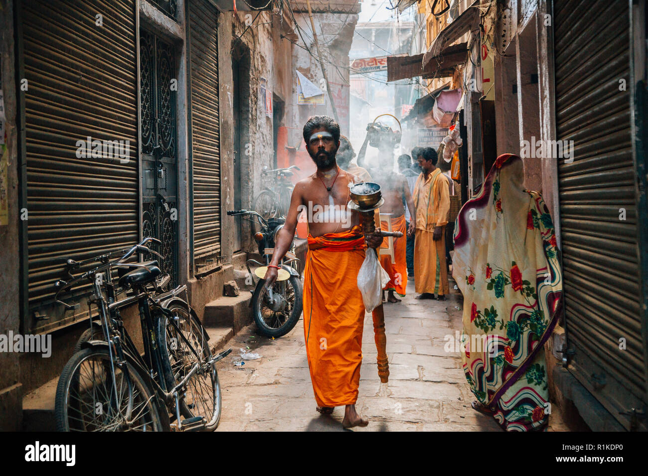 Varanasi, India - November 23, 2017 : Hindu perform worship ceremony at Bangali Tola old street Stock Photo