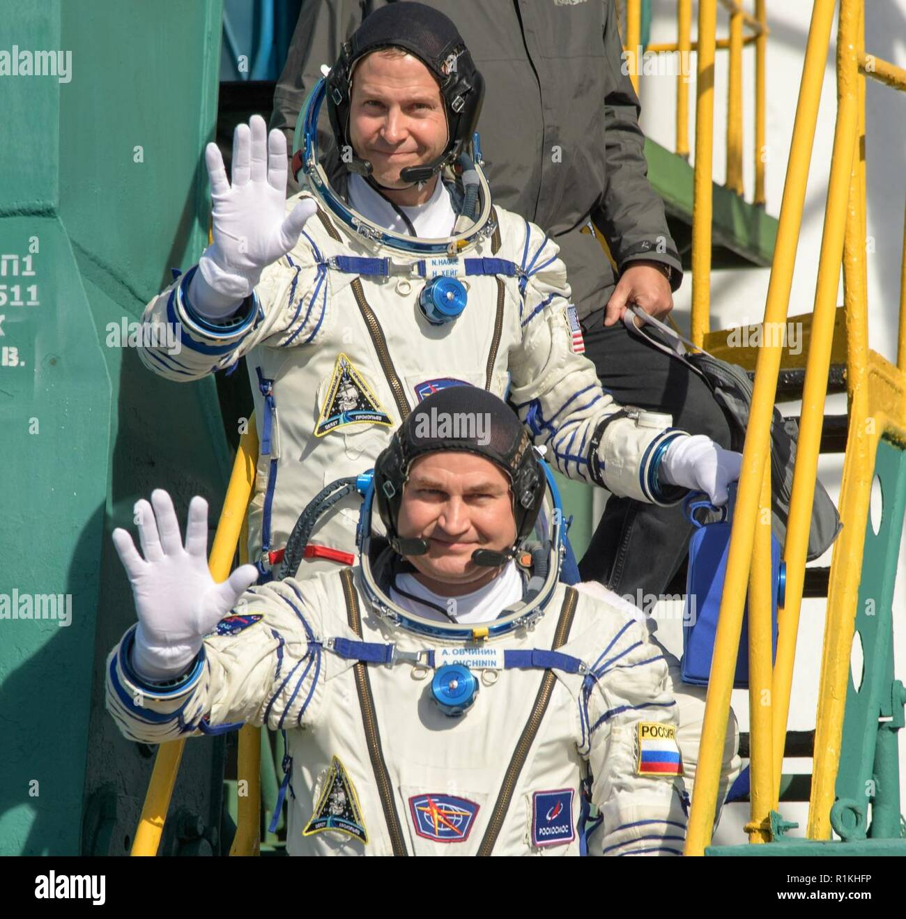 Expedition 57 Flight Engineer Nick Hague of NASA, top, and Flight Engineer Alexey Ovchinin of Roscosmos, wave farewell prior to boarding the Soyuz MS-10 spacecraft for launch, Thursday, Oct. 11, 2018 at the Baikonur Cosmodrome in Kazakhstan. Hague and Ovchinin will spend the next six months living and working aboard the International Space Station. - Stock Image
