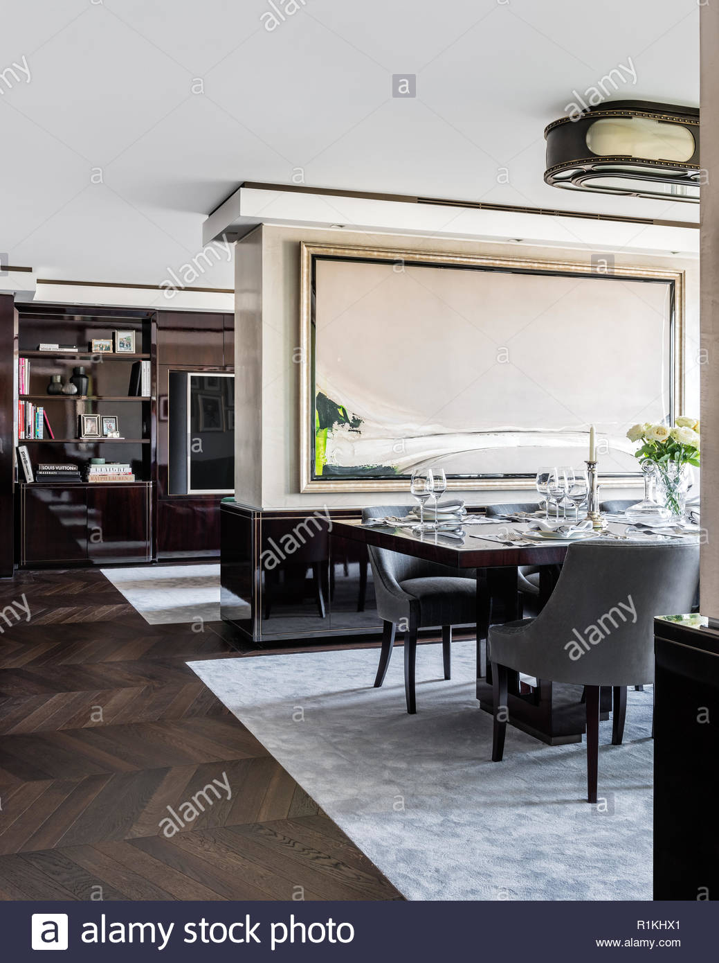 Set table in modern apartment dining room Stock Photo: 224780585 - Alamy