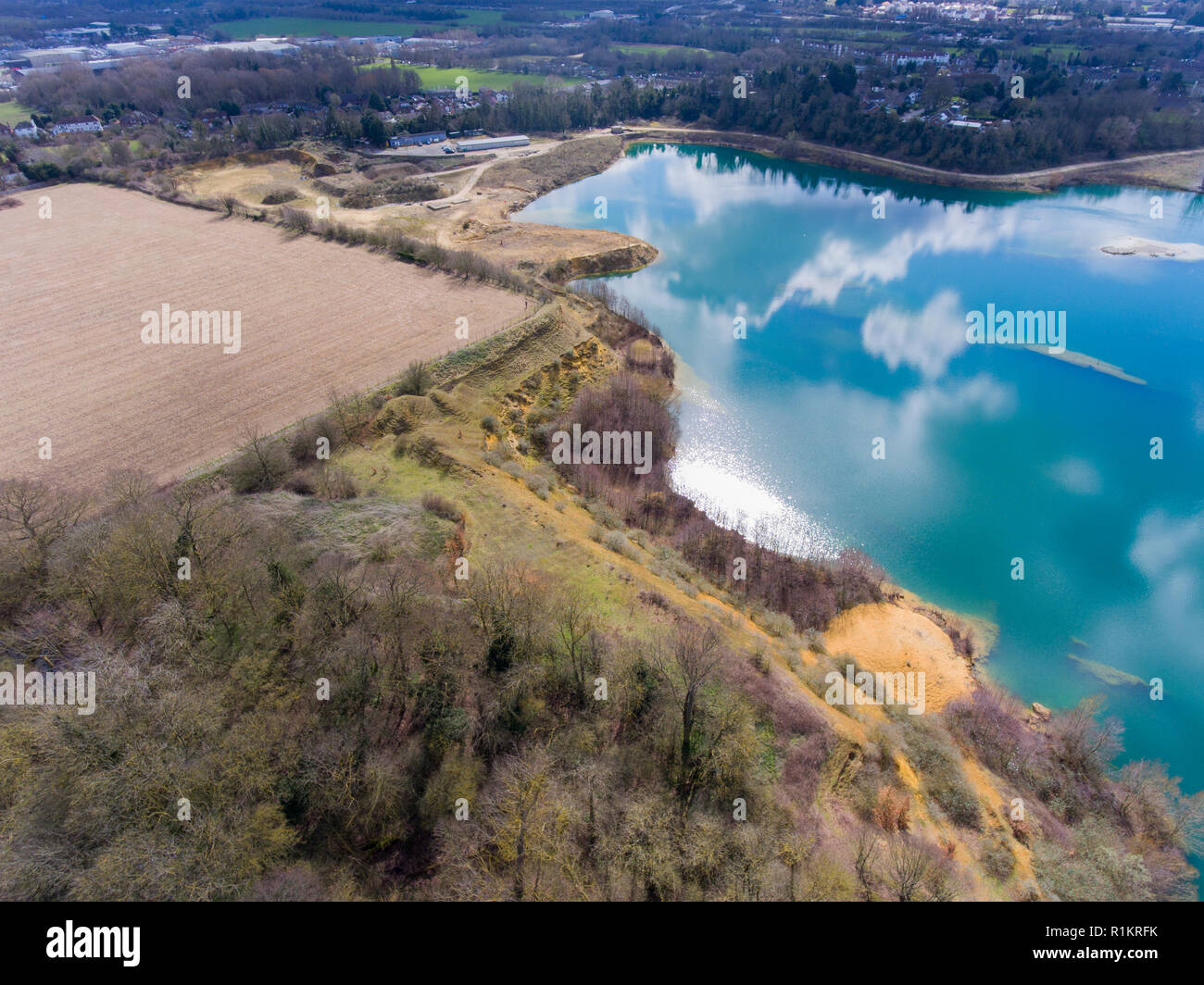 Blue water in a disused quarry Stock Photo