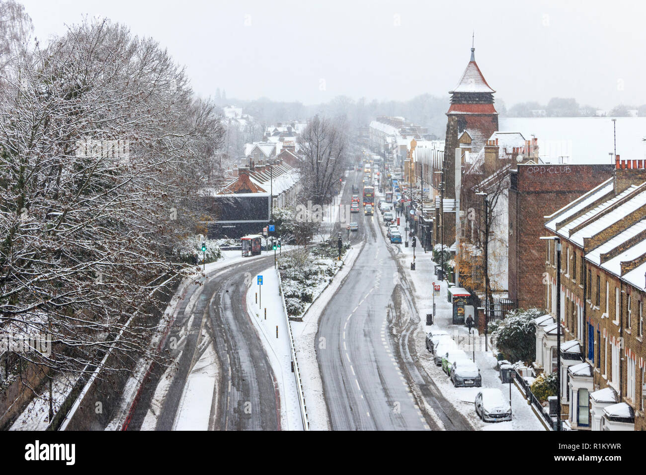 The A1 Archway Road, looking north from Hornsey Lane Bridge, London, UK, in the snow. St. Augustine's Church in the right. - Stock Image