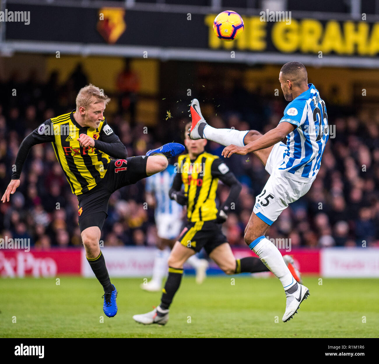 WATFORD, ENGLAND - OCTOBER 27: Will Hughes of Watford FC and Mathias Jørgensen of Huddersfield Town during the Premier League match between Watford FC and Huddersfield Town at Vicarage Road on October 27, 2018 in Watford, United Kingdom. (MB Media) - Stock Image
