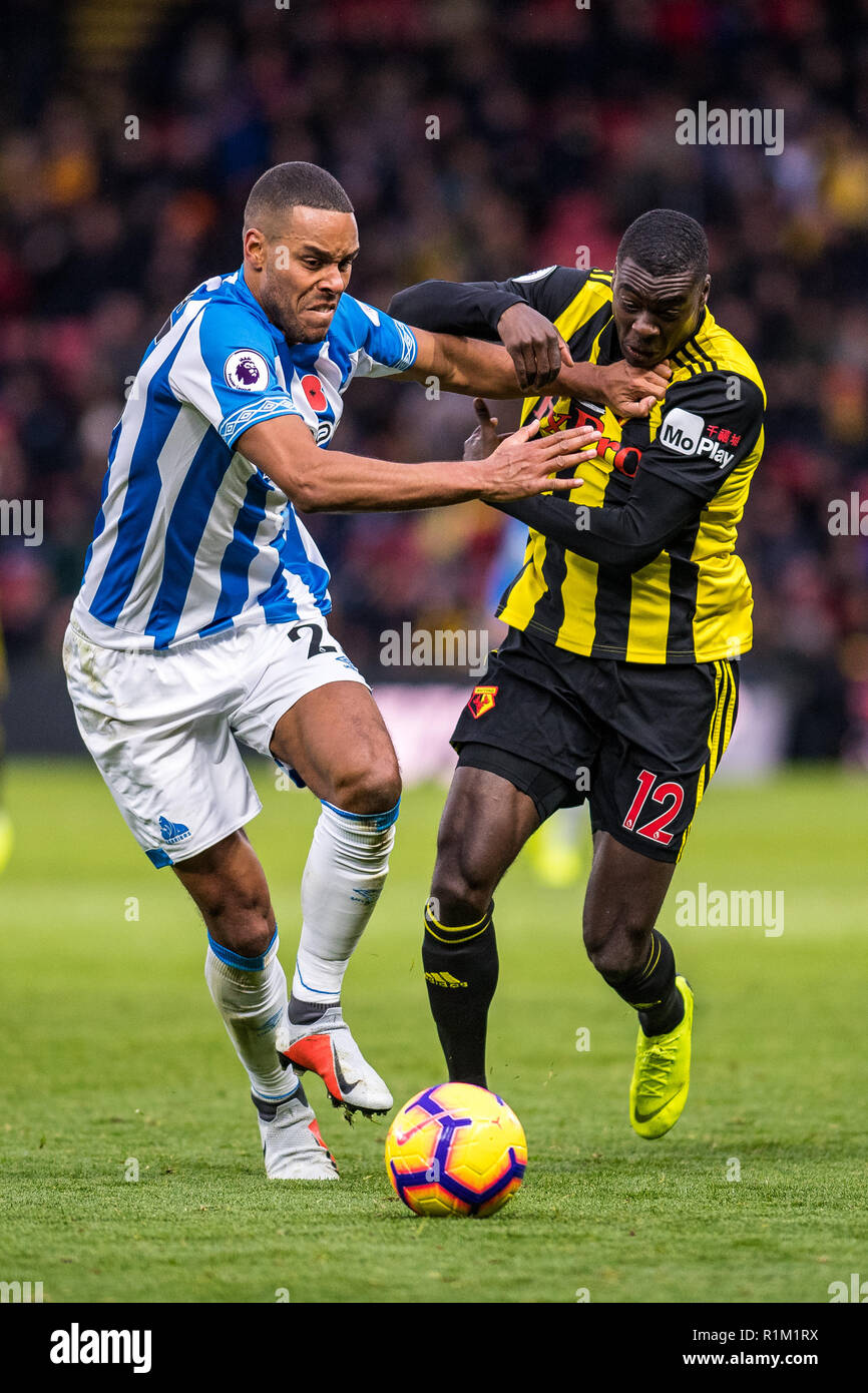 WATFORD, ENGLAND - OCTOBER 27: Ken Sema of Watford FC and Mathias Jørgensen of Huddersfield Town during the Premier League match between Watford FC and Huddersfield Town at Vicarage Road on October 27, 2018 in Watford, United Kingdom. (MB Media) - Stock Image