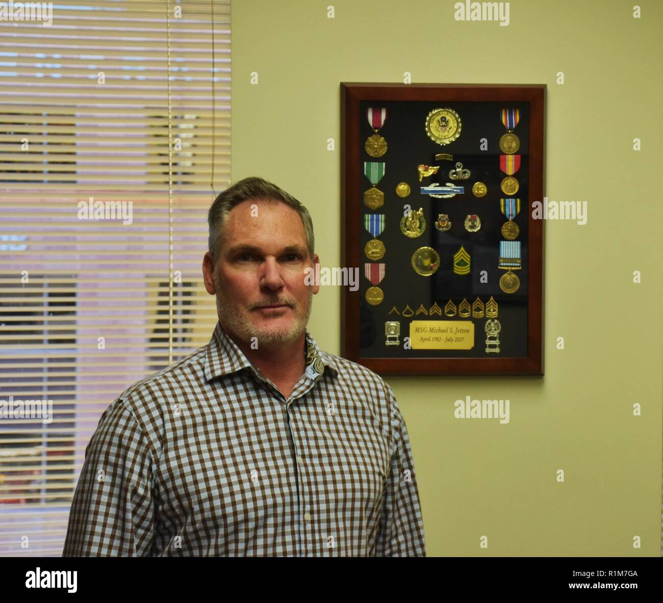 Retired Master Sgt. Mike Jetton stands by his military decorations and awards, including the Combat Infantryman Badge he earned in Grenada, during Operation Urgent Fury in Oct. 1983, Oct. 18, Phoenix Recruiting Battalion Headquarters, Phoenix. Jetton was a nineteen year old specialist serving with the 82nd Airborne Division as a paratrooper, when his battalion was deployed to engage in the operation. ( - Stock Image