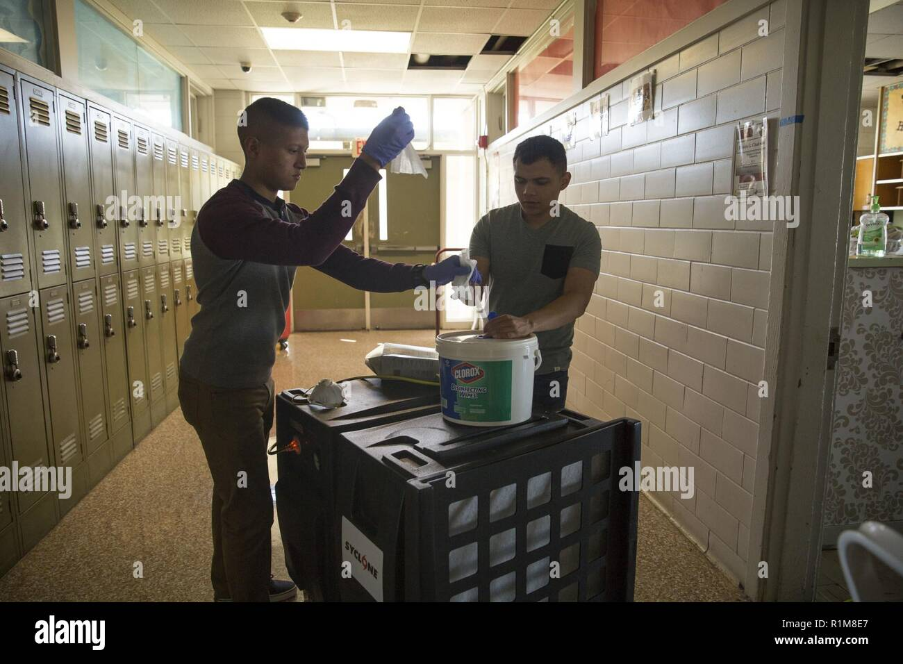 U.S. Marines with 3rd Battalion, 6th Marine Regiment, 2nd Marine Division assist with the clean-up after Hurricane Florence at Jacksonville High School in Jacksonville, N.C., Oct. 19, 2018. Marines have assisted with cleaning up in the aftermath of Hurricane Florence, the largest storm to hit the Carolinas since Hurricane Floyd in 1999. - Stock Image