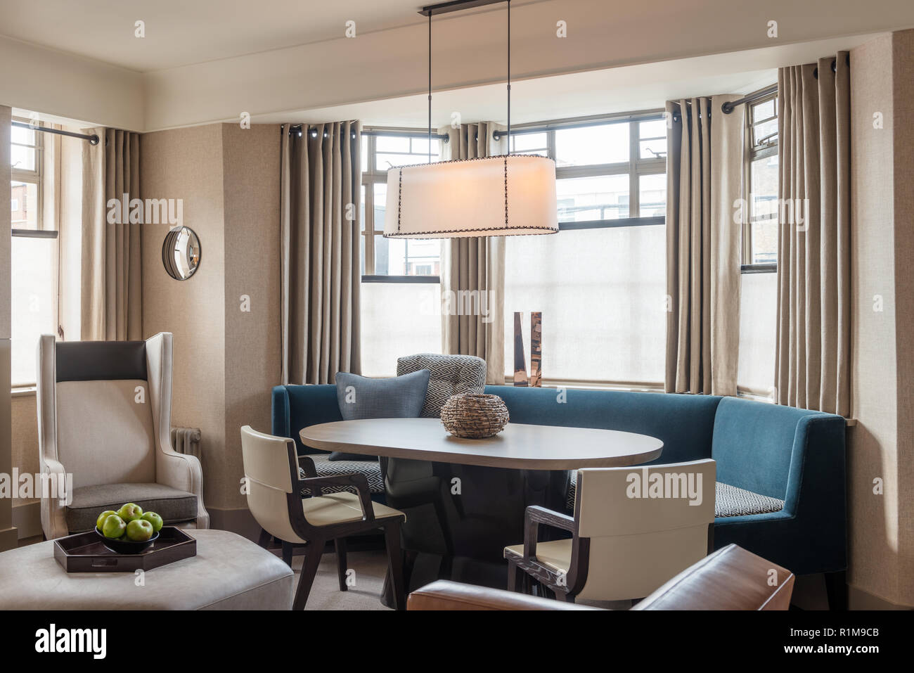 Blue And Grey Toned Dining Room By Bay Window Stock Photo Alamy
