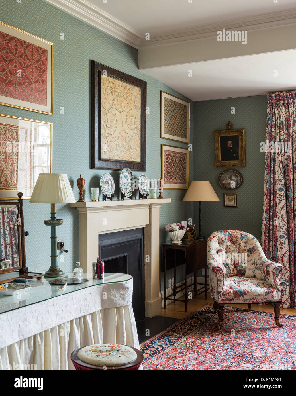 Fireplace in Edwardian bedroom - Stock Image