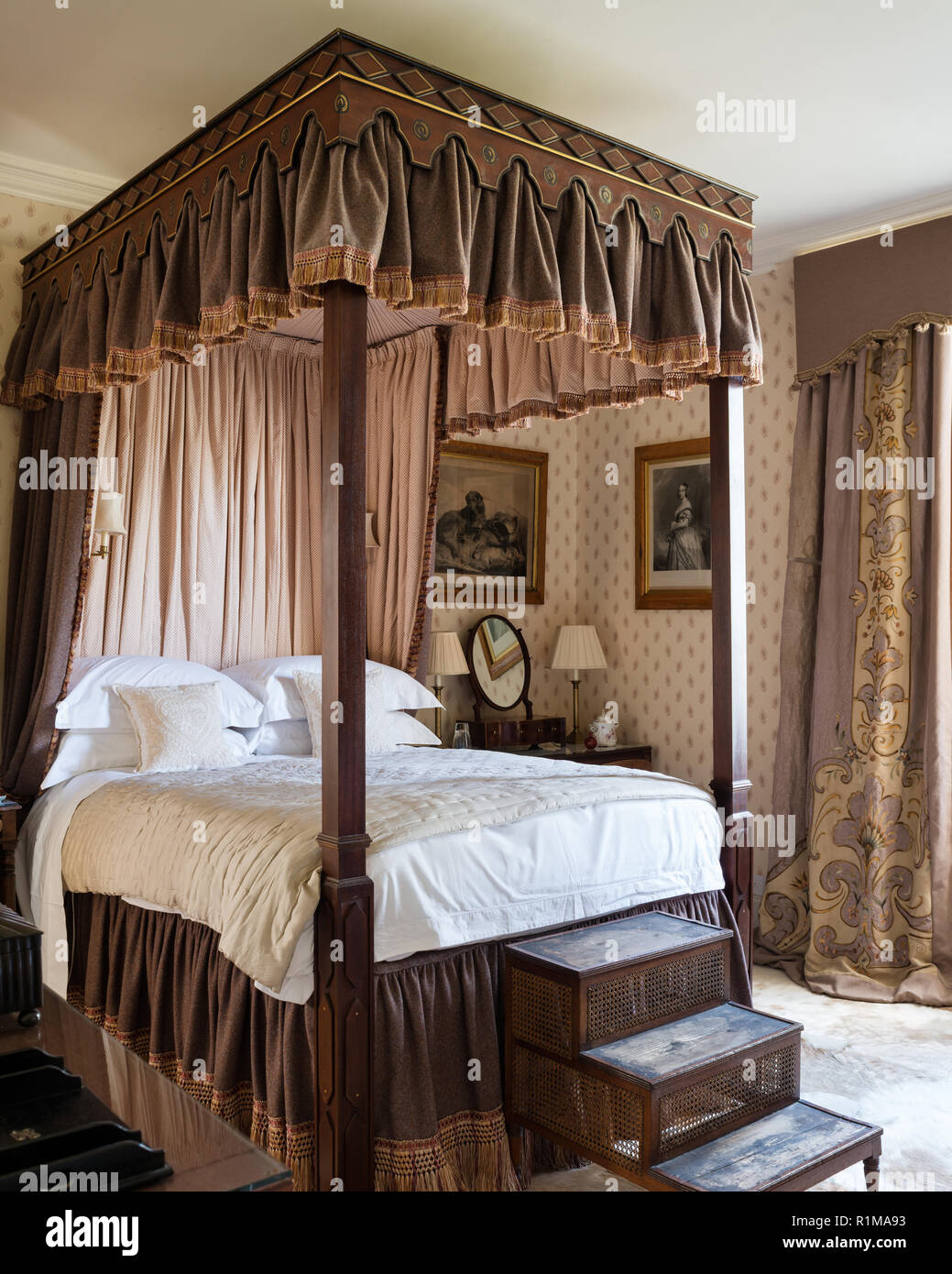 Brown and white canopy bed Stock Photo