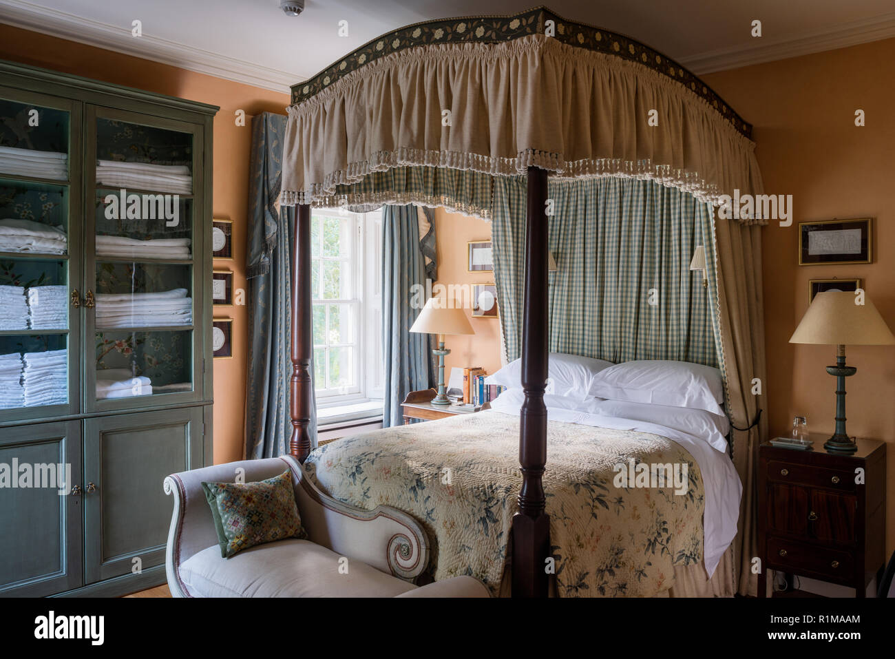 Canopy bed in Edwardian style bedroom - Stock Image