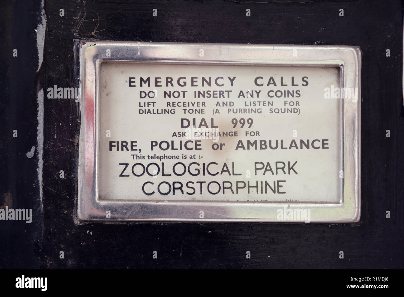 Real sign on a phone box at Edinburgh Zoo. - Stock Image