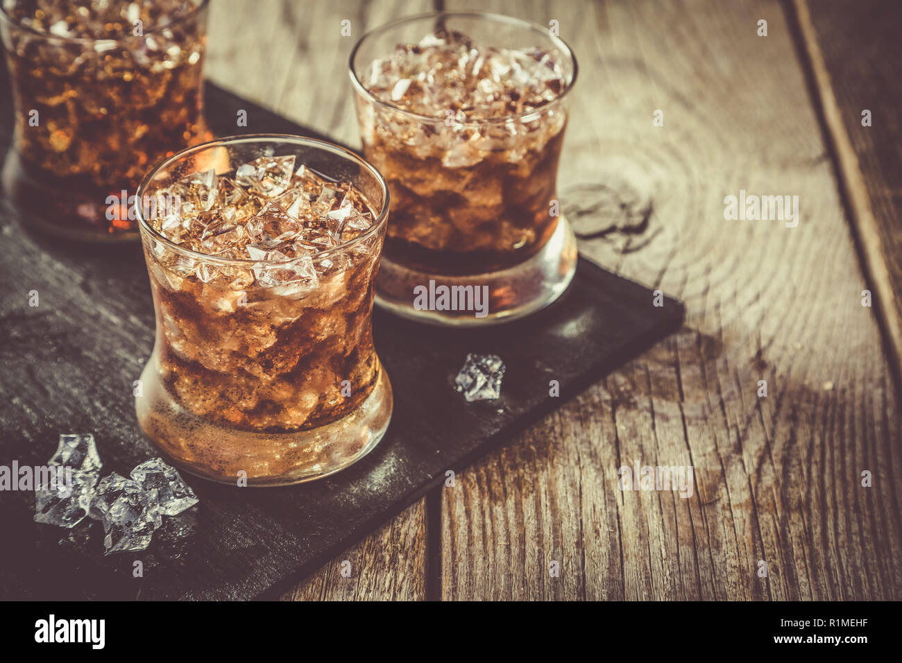Rum and cola cocktail in glasses - Stock Image