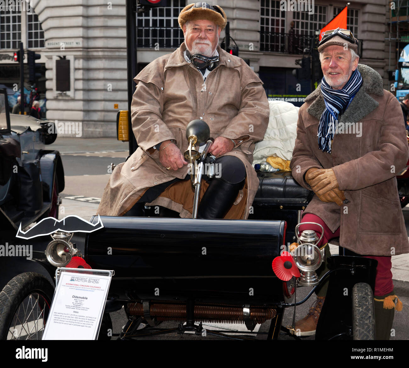 Dr Seiderman  in his 1903 Oldsmobile Curved-dash runabout, participating in the veteran car Concourse d'Elegance at the Regents Street Motor Show 2018 Stock Photo