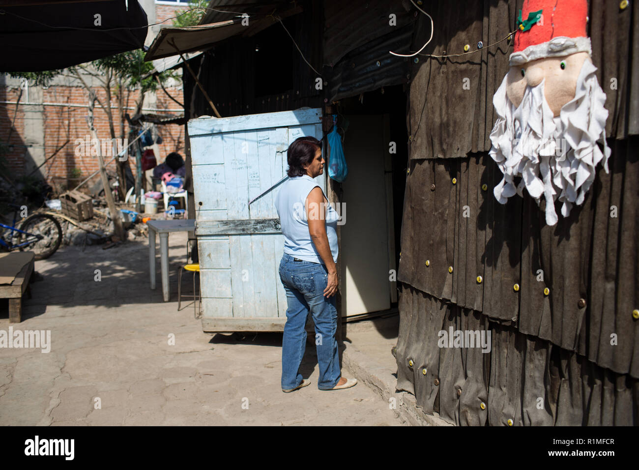 Bertha Moreno Garcia washes dishes outside of her house in Iguala, Guerrero, Mexico, February 6, 2016. Moreno Garcia's son Jose Manuel Cruz Moreno was last seen January 2, 2009 from a small community on the outskirts of Iguala. He was 22 years old.   Jose Manuel left the house, telling his mother he was going to buy new shoes and then go to a party celebrating the anniversary of a Colonia. His younger brother saw him drunk that night, that was the last time he was seen.   ÒIt is very heavy for me,Ó said Bertha. ÒWe went to search, we went to the hospital, we went to the jail, the Colonia he we Stock Photo