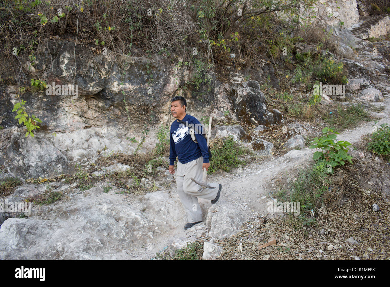 Victor Tepec Velez, leaves his house on the outskirts of Iguala, Guerrero, Mexico, February 7, 2016. Tepec Velez's son Jesus David Tepec Avalos, went missing while driving a local bus in Iguala. Jesus was 29 years old, when he disappeared April 30, 2014. Jesus' bus was found with the doors open and the keys in the ignition, his family hasn't seen him since.    ÒWe just want to find him, weather he is dead or alive,Ó said Victor. He and his 13 year old daughter Guadalupe take part in weekly searches for clandestine graves with other family members of missing people.   ÒShe (Guadalupe) is very p Stock Photo